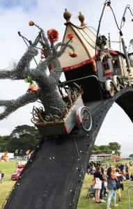 A fairy tale train and ornate carriages over the entrance Bestival Festival, Dorset England