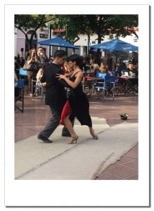 A couple in traditional attire, demonstrate the Tango outside a cafe, Buenos Aires, Argentina