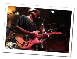 Two Blues musicians, one on guitar and one on saxaphone on stage, Chicago blues club