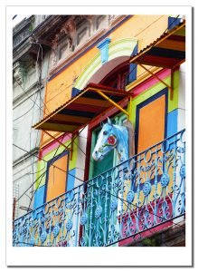 A First Timer's Guide to Argentina, A horses head motif, on the outside wall of a colour painted house in Buenos Aires, Argentina