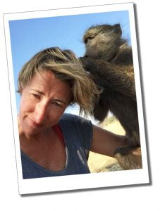 SueWhereWhyWhat getting groomed on the Baboon walk (with the adults) near Naankuse Wildlife Sanctuary Namibia