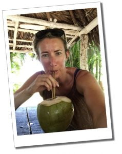SueWhereWhyWhat drinking a rum cocktail from a Coconut in the Caribbean