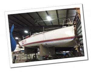 The yacht Red Hot in a shed undergoing repairs