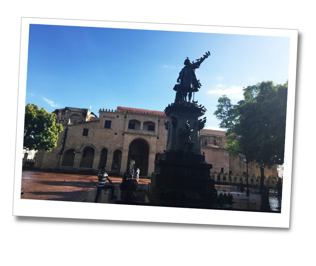 A statue covered in pigeons in the town square Zona Colonia, The Dominican Republic