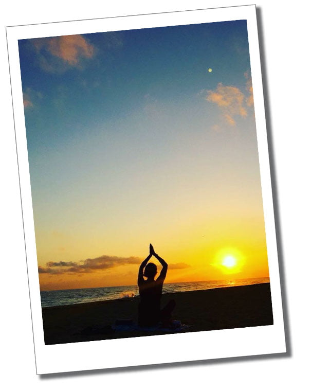 SueWhereWhyWhat strikes a yoga pose at sunrise on the beach in Cuba.
