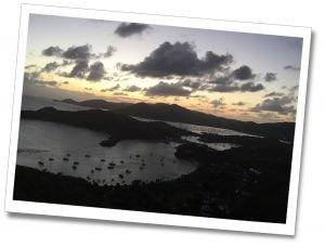 The view of the bay, Shirley Heights, Antigua as the sun sets behind the mountains