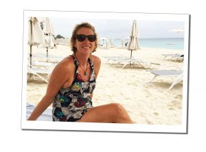 Suewherewhywhat relaxing on the white sand of 7 mile beach in Grand Cayman, Caribbean