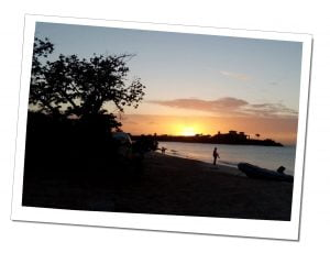 Silhouetted people on the beach in a Dramatic sunset, Buccaneer Cove, Caribbean
