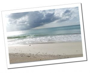 The deserted Fort James beach, sand & gently lapping sea, Antigua, Caribbean