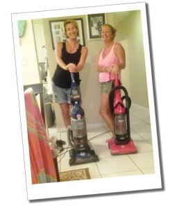 Suewherewhywhat & friend leaning up their vacuum cleaners. Grand Cayman, Caribbean