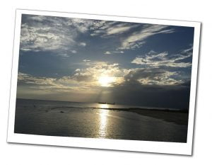 A picture of the late afternoon sunset over the sea on 7 mile beach, Grand Cayman