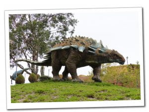 Full size replica of an Ankylosaurus Dinosaur on a grass verge, Sucre, Bolivia