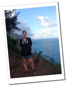 Hiking as a solo female, SueWhereWhyWhat standing on the cliffs when Hiking the Kalalau Trail, Hawaii