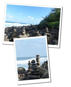 Hiking as a solo female, Piles of different sized stones, Kauai beach, Hawaii