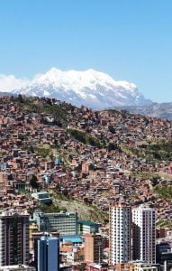 A view of the houses on the hills of La Paz, Bolivia, from Mirador Killi & a giant snow capped peak behind. A First Timer's Guide to Bolivia