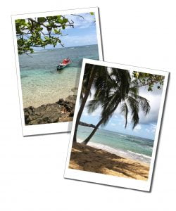 Deserted beach & boat bobbing on tranquil sea, Martinique, Caribbean