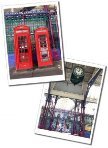 Smithfield Market clock and red london telephone boxes, London