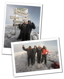 SWWW and Brigit and guides at the Uhuru the sign at the summit, Kilimanjaro