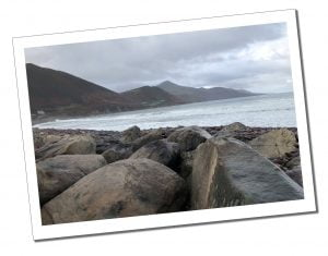 Rocky beach and mountainous backdrop at Rossbeigh Strand on the Ring of Kerry
