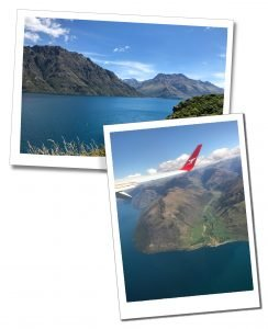 View of blue lakes and mountains from an aeroplane arriving in Queenstown, New Zealand