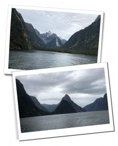Dark imposing mountains skirting the water of Milford Sound, New Zealand