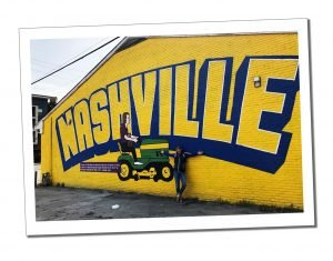 SWWW and big yellow painted sign saying Nashville