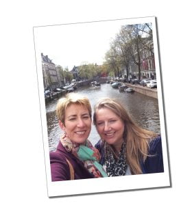Short Travel Stories from the air - SWWW and Gemma on an Amsterdam bridge over a canal