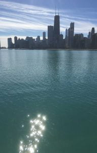 A magical sparkle shoots across the still waters of Lake Michigan, Chicago