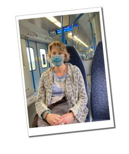 SWWW in mask on a train - Top Tips to Travel Safely during COVID 19